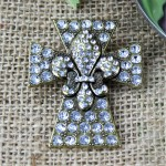 1029CL - CLEAR STONE CROSS CANDLE PIN W / FDL